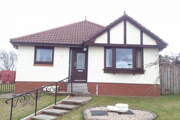 white render with brown trim