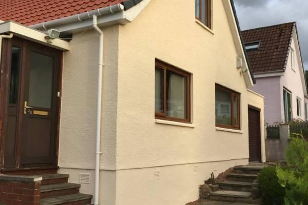 cream render porch entrance