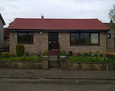 stone house red flat roof