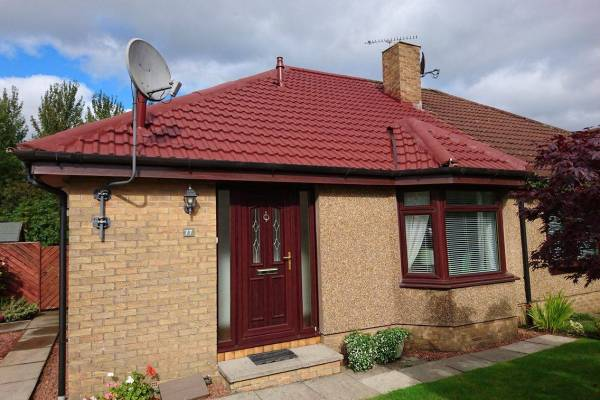 house with satellite dish on red roof