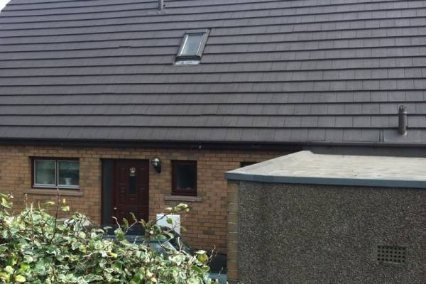 grey roof and brick house after