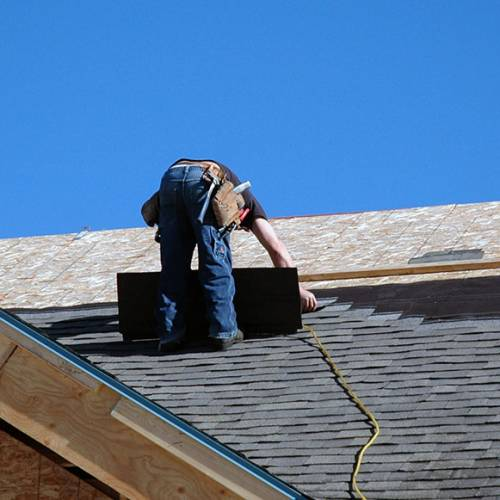man slating on roof