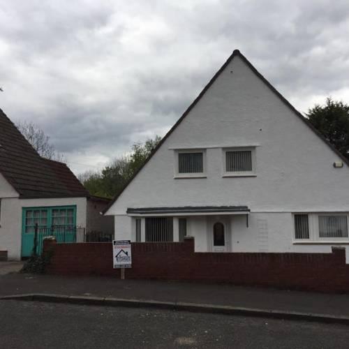 white triangle house on street